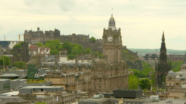 lockdown shot of famous landmarks in city against cloudy sky - edinburgh, scotland - edinburgh scotland stock videos & royalty-free footage