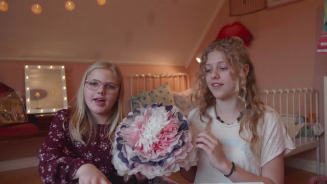 lockdown shot of female vloggers explaining diy craft product while sitting in bedroom - craft stock videos & royalty-free footage