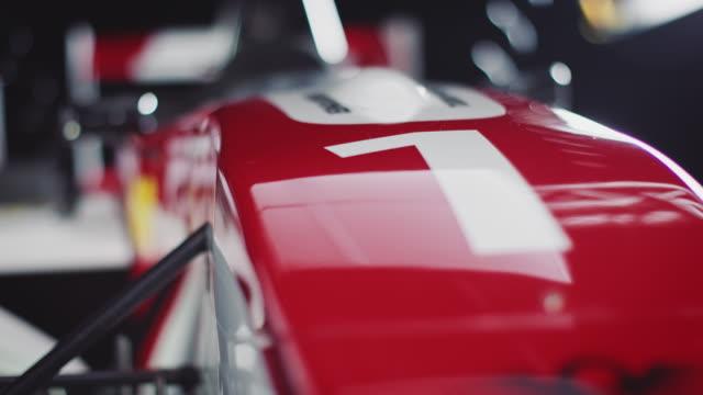lockdown shot of number 1 on red racecar - number 1 stock videos & royalty-free footage