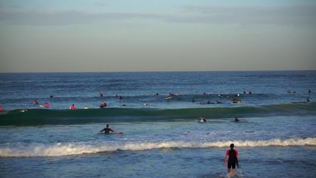 lockdown shot of people surfing on waves in sea against sky - jaffa, israel - jaffa stock videos & royalty-free footage