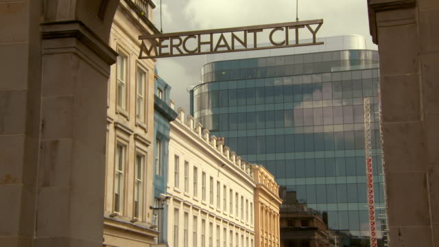 lockdown shot of sign hanging at archway against modern building in city - glasgow, scotland - capital letter stock videos & royalty-free footage