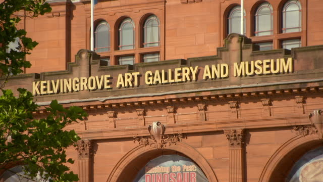 lockdown shot of sign on famous art gallery and museum building in city on sunny day - glasgow, scotland - capital letter stock videos & royalty-free footage