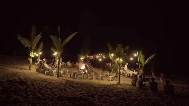 lockdown shot of tourists camping at illuminated beach against sky during night - luang prabang, laos - film festival stock videos & royalty-free footage