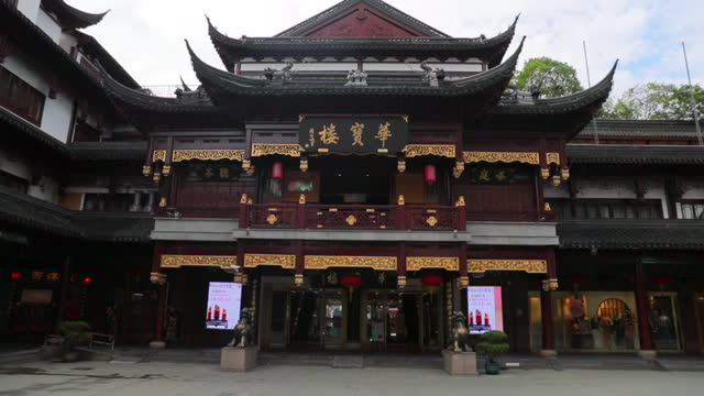 lockdown shot of traditional building facade in city against sky - shanghai, china - pagoda stock videos & royalty-free footage