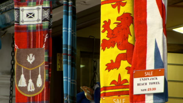 lockdown shot of various beach towels with sign hanging at store in city - edinburgh, scotland - western script stock videos & royalty-free footage