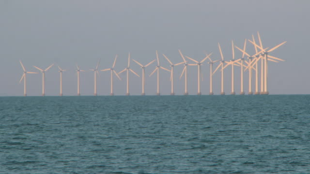 lockdown shot of wind turbines in sea against clear sky - copenhagen, denmark - wind stock videos & royalty-free footage
