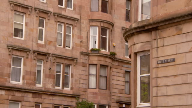 lockdown shot of windows on residential buildings in city - glasgow, scotland - western script stock videos & royalty-free footage