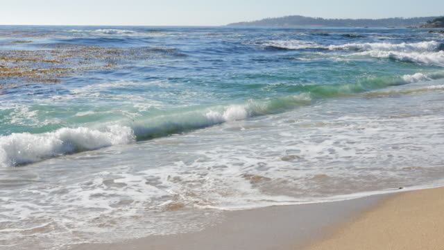 lockdown slow motion: waves splashing on the carmel beach of california with majestic view of the area - carmel, california - majestic stock videos & royalty-free footage
