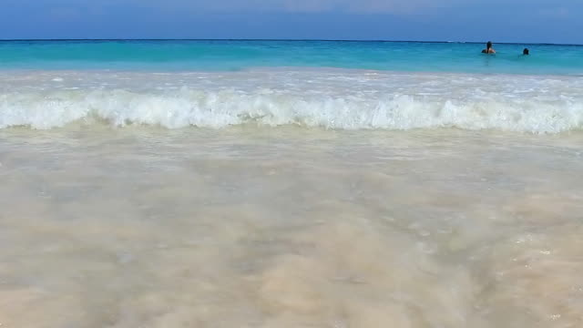 lockdown slow-motion: waves hitting the shores of hamilton bermuda in hamilton, bermuda - bermuda stock videos & royalty-free footage