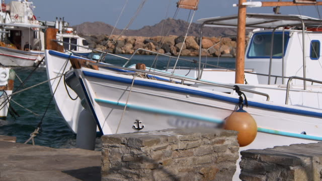 lockdown: stunning yachts bob in the gorgeous rocky harbor of naoussa - schiffsdeck stock-videos und b-roll-filmmaterial