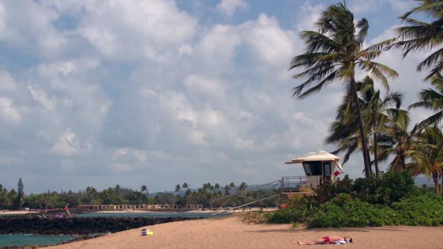 stockvideo's en b-roll-footage met lockdown: sunbathing beside lifeguard tower - badmeester
