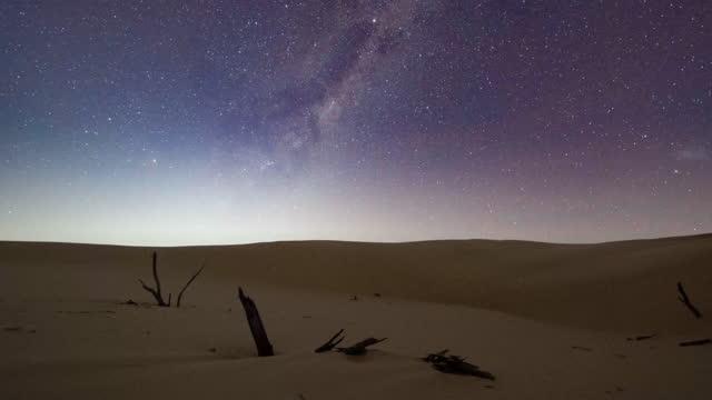 lockdown time lapse: sand dunes against galaxy at night - stockton sand dunes, australia - sand dune stock videos & royalty-free footage