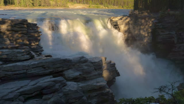 lockdown time lapse shot of cascade through rocks at famous national park - jasper national park, canada - jasper national park stock videos & royalty-free footage