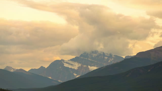 lockdown time lapse shot of clouds covered mount edith cavell against sky at national park during sunset - jasper national park, canada - jasper national park stock videos & royalty-free footage