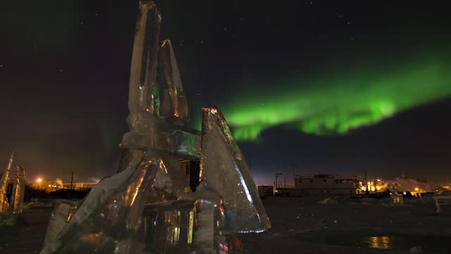 lockdown time lapse shot of ice sculpture below northern lights in sky during winter - british columbia, canada - fast motion stock videos & royalty-free footage
