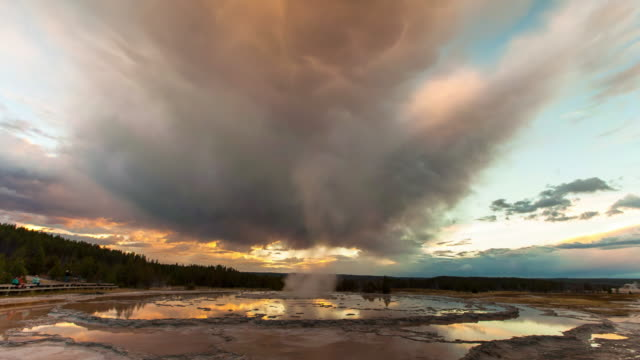 lockdown time lapse shot of mammatus clouds over geyser against sky during sunset - yellowstone national park, wyoming - yellowstone national park stock videos & royalty-free footage