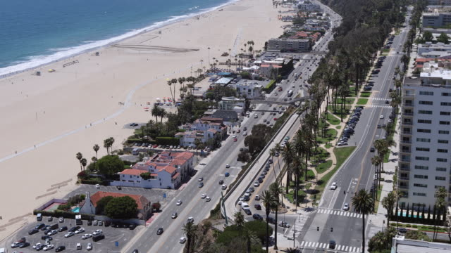 lockdown time lapse shot of vehicles on road by beach in city during sunny day - santa monica, california - santa monica house stock videos & royalty-free footage