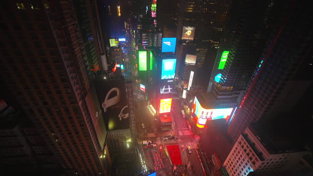 lockdown time lapse shot of vehicles on street at famous times square plaza with illuminated billboards during night - new york city, new york - fast motion stock videos & royalty-free footage