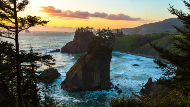 lockdown time lapse shot of waves splashing on rock formation against sky at sunset, beach time lapse - oregon us state stock videos & royalty-free footage