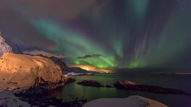 lockdown time-lapse: dancing green aurora borealis sky in hamnoy norway - hamnoy, norway - aurora borealis stock videos & royalty-free footage