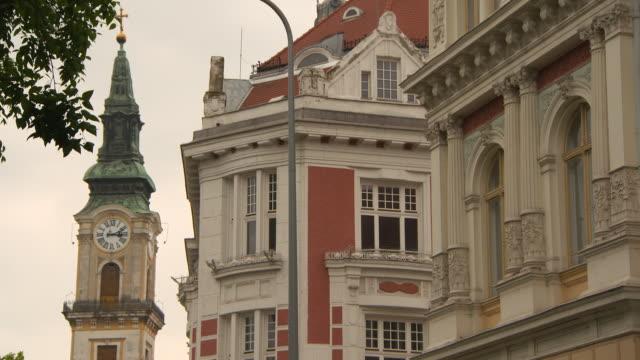 vídeos y material grabado en eventos de stock de lockdown: upper stories of lovely buildings and clock tower of reformed church - detalle arquitectónico exterior