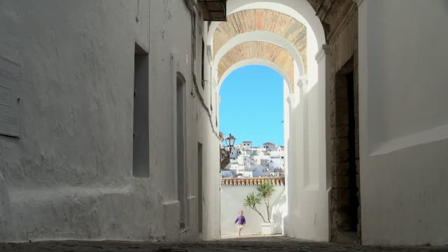 lockdown: view of white homes and kid in spain - arch architectural feature stock videos and b-roll footage