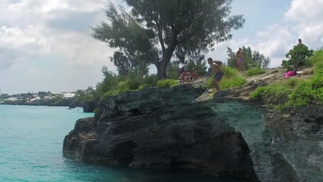 lockdown: watching people cliff diving in the hamilton bermuda in hamilton, bermuda - bermuda stock videos & royalty-free footage