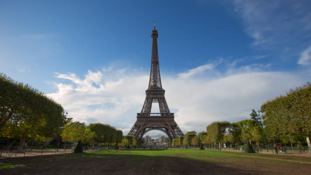 lockdown wide time-lapse: the eiffel tower of paris with clouds moving fast in the background - wide stock videos & royalty-free footage