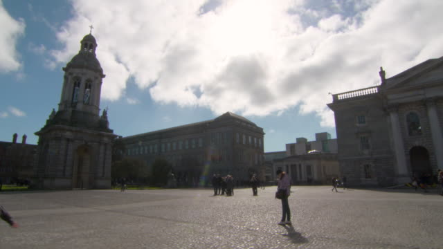 lockdown wide: view of the vast space of trinity college in dublin ireland - establishing shot stock videos & royalty-free footage