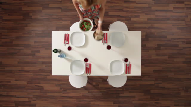 MS, Lockdown, woman setting the table, overhead view
