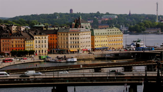 locked down shot of gamla stan and traffic and trains crossing bridges in fast motion / stockholm, sweden - sweden stock videos & royalty-free footage