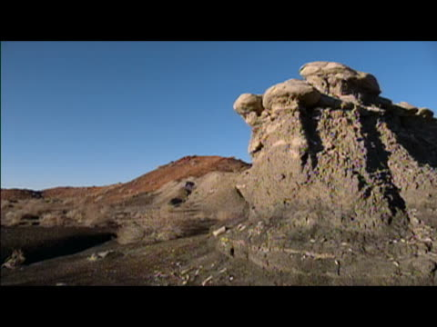 locked down wide shot of rock formation in badlands of bisti/de-na-zin wilderness area / new mexico - wilderness area stock videos & royalty-free footage