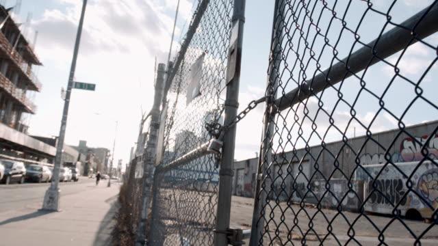 locked gate - brooklyn - fence stock-videos und b-roll-filmmaterial