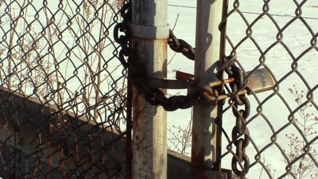 cu, tu, locked gate surrounding general motors auto assembly plant, lansing, michigan, usa - lansing stock videos & royalty-free footage