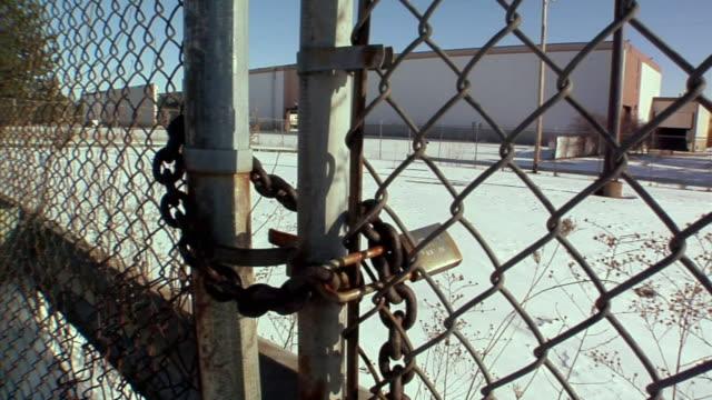 CU, PAN, Locked gate surrounding General Motors auto assembly plant, Lansing, Michigan, USA