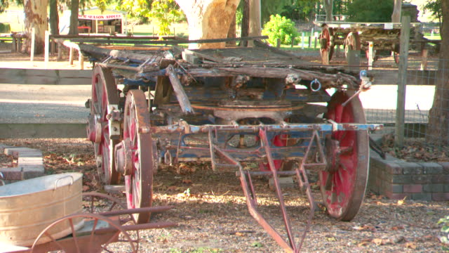 locked off shot rustic weathered looking horse wagon at tourist site - rustic stock videos & royalty-free footage