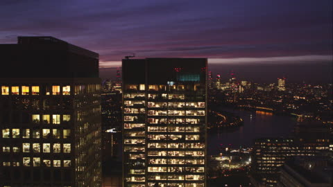 locked off tight shot shot of office block at dusk - real time stock videos & royalty-free footage
