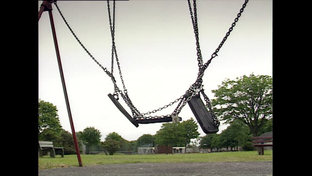 cu of locked swings in playground moving in breeze; 1993 - 1993 stock videos & royalty-free footage