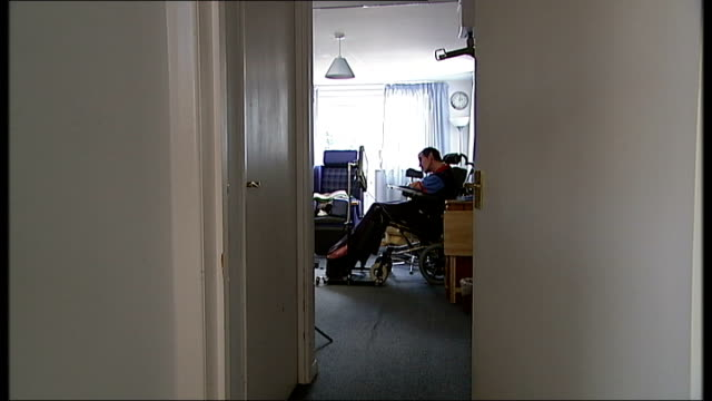 'locked-in syndrome' sufferer goes to high court to let doctor end his life; tx 18.6.2012 wiltshire: chippenham: int tony nicklinson in wheelchair at... - チッペナム点の映像素材/bロール