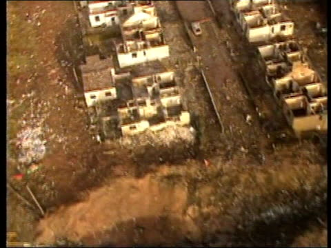 lockerbie air view crater and wrecked houses left after being struck by falling debris from pan am flight 103 crater wrecked house at night burnt out... - lockerbie stock videos & royalty-free footage