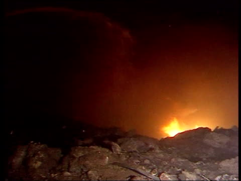 lockerbie fire burning around crater left after wing of pan am flight 103 crashed to the ground firemen fighting fire water being hosed onto fire... - lockerbie stock videos & royalty-free footage
