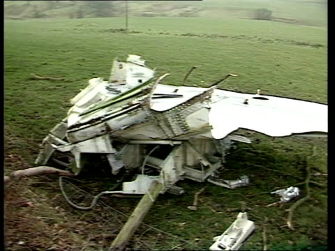 debris clearing operations itn scotland dumfries galloway lockerbie westland puma helicopter lifting pieces of wreckage from pan am boeing 747... - lockerbie stock videos & royalty-free footage