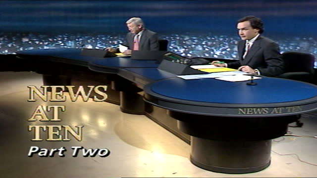 news at ten pab; england: london: itn house: int sandy gall and alastair stewart live studio - itv news at ten stock videos & royalty-free footage