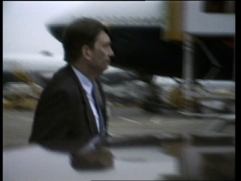 stockvideo's en b-roll-footage met paul channon brenards paul channon mp arriving home from holiday in caribbean pan lr as press in b/g track forward as in bv and into car - dumfries en galloway