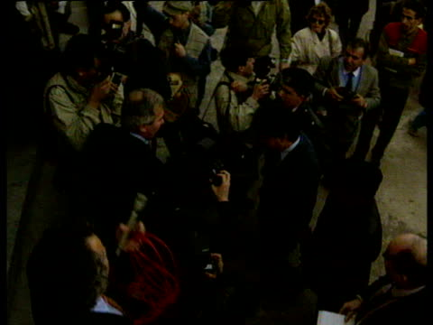 lockerbie bombing suspects ali amin khalifa fhimah and abdel basset ali moh'med almegrahi are surround by press as they are escorted into tripoli... - court hearing stock videos and b-roll footage