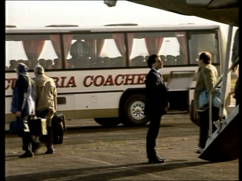 us relatives itn england cumbria carlisle airport us relatives from steps aircraft to coach ms ditto ms coffin carried - lockerbie stock videos & royalty-free footage