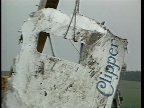 lockerbie: ext 1988 air view debris of pan am flight 103 on ground between houses large piece of fuselage being winched away from site of crash... - week stock videos & royalty-free footage