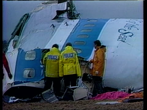 pan am guilty of willful misconduct 221288 scotland lockerbie seq workers examining wreckage of pan am flight in field - lockerbie stock videos & royalty-free footage