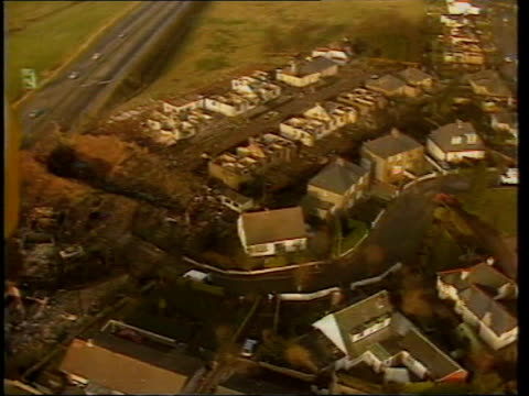 verdict announced lib shells of wrecked houses and crater from plane crash - lockerbie stock videos & royalty-free footage