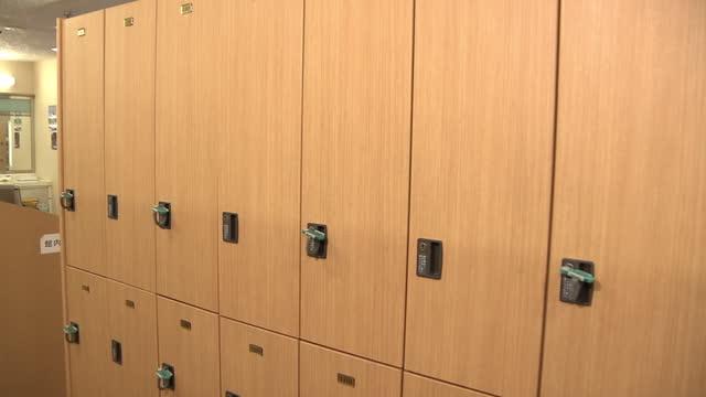 cu, lockers at public bathhouse, tokyo, japan - cabinet stock videos & royalty-free footage